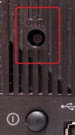 picture of router reset button; back of router