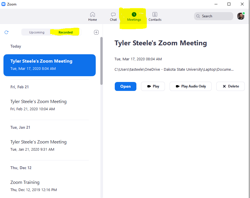 """Shows the Zoom app. The meeting tab at the top is highlighted to show it has been selected. On the left column a the """"recorded"""" button is highlighted to show it has been selected.A list of all Zoom recordings are on the left side. The right side shows information about the selected Zoom recording on the left side. On the right side there are buttons to either open, play, or play audio of the Zoom recording."""